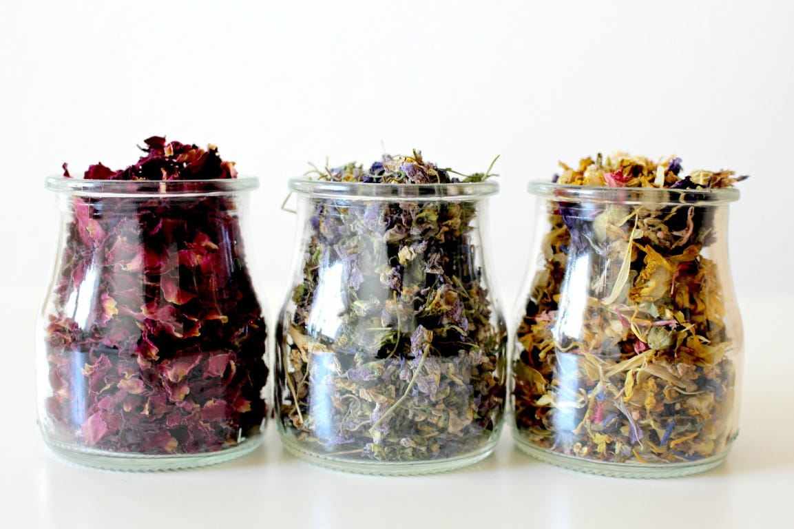 dried flowers in three glass jars