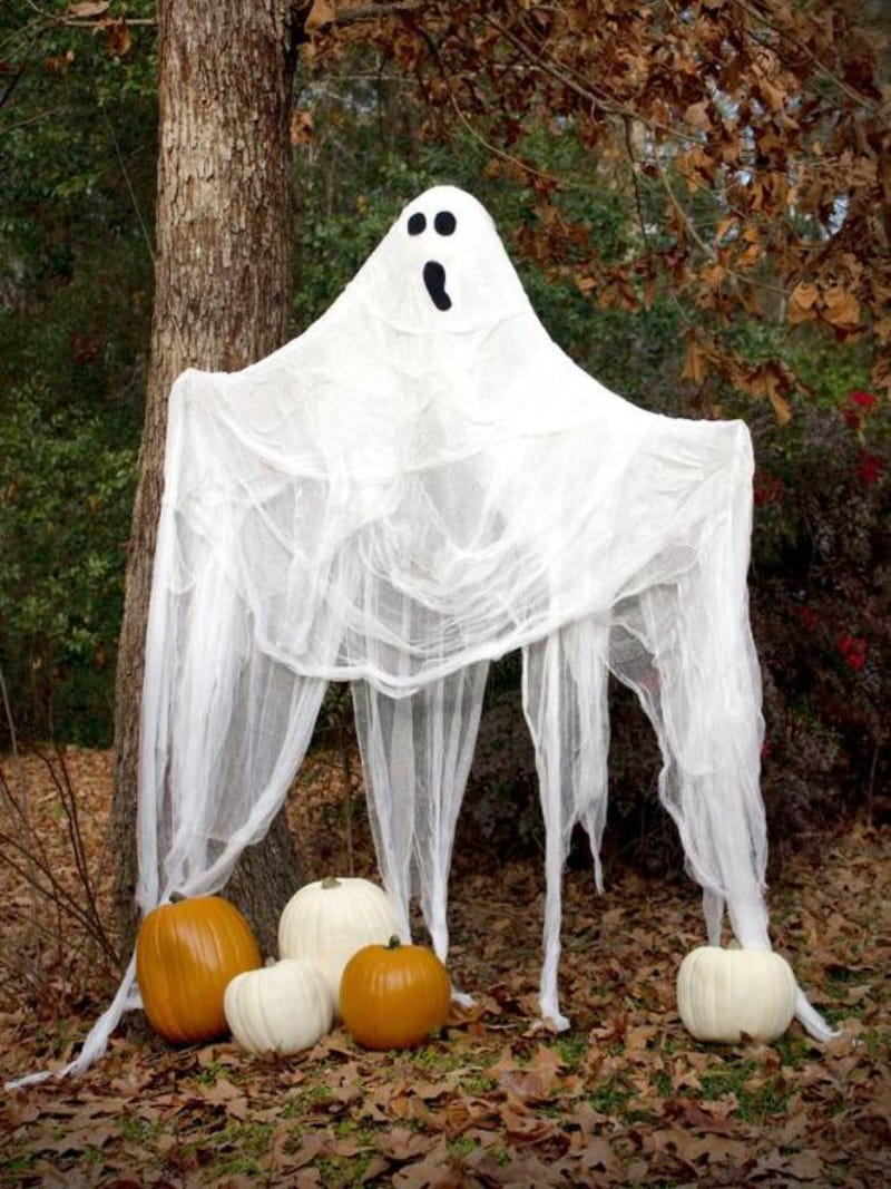 Halloween ghost decoration with white bed sheet