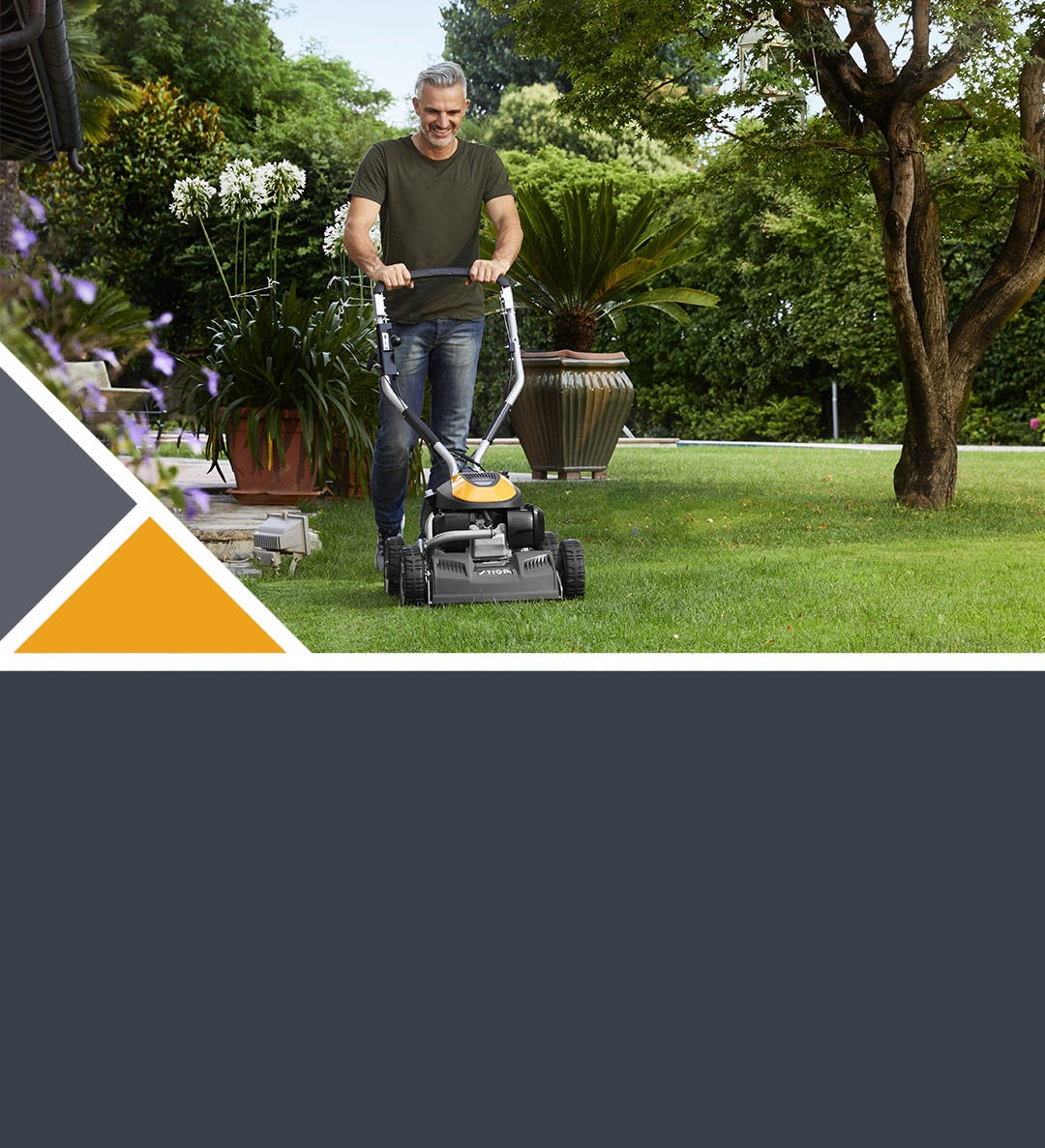Man mowing the lawn with a STIGA Multiclip Pro lawn mower